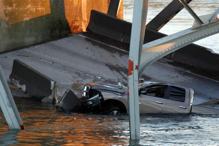 A truck is seen in the water after a portion of the Interstate 5 bridge collapsed into the Skagit River in Mount Vernon, Wash. (Jennifer Buchanan / The Associated Press)