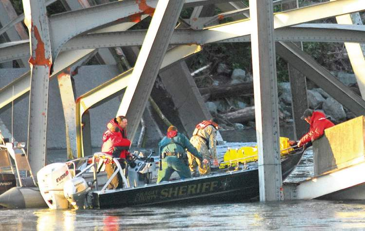 A person is removed from the wreckage of the collapsed Interstate-5 bridge.