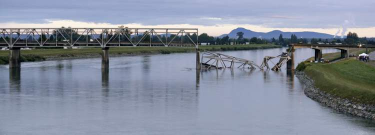 The north end of the Interstate 5 bridge crossing the Skagit River lies collapsed in the water Friday