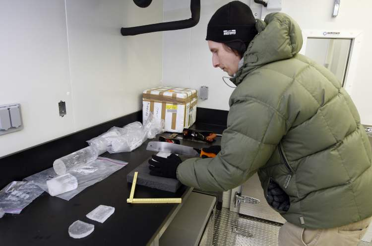 Dr. Jens Ehn  cuts arctic ice core in his cold temperature lab in the new $15 million research centre — the Nellie Cournoyea Arctic Research Facility — at the University of Manitoba.