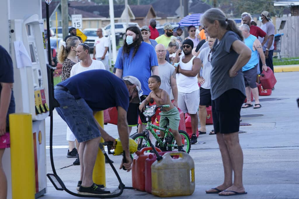 Residents line up for fuel Wednesday in Belle Chasse, La.  (Steve Helber / The Associated Press)