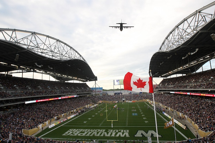 A Canadian Forces C130 Hercules does a fly-by during Oh Canada. (JOE BRYKSA / WINNIPEG FREE PRESS)