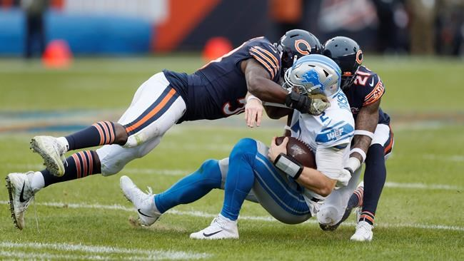 Detroit Lions quarterback Jeff Driskel (2) is sacked by Chicago Bears inside linebacker Roquan Smith (58) and strong safety Ha Ha Clinton-Dix (21) during the second half of an NFL football game in Chicago, Sunday, Nov. 10, 2019. (AP Photo/Charlie Neibergall)