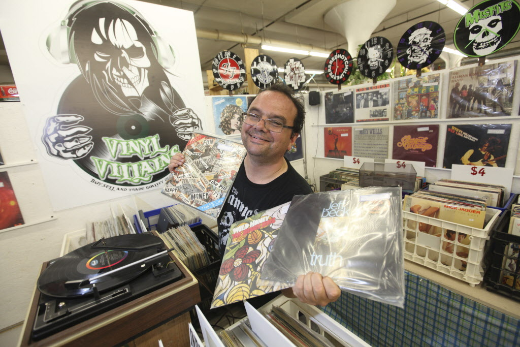 John McGowan and his partner opened Vinyl Villains at Thirsty's in 2012. (Ruth Bonneville / Winnipeg Free Press)