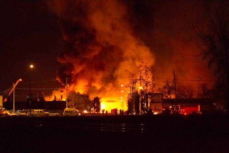 Firefighters continue battling the blaze after dark. (Diane Hammerling / Submitted Photo)