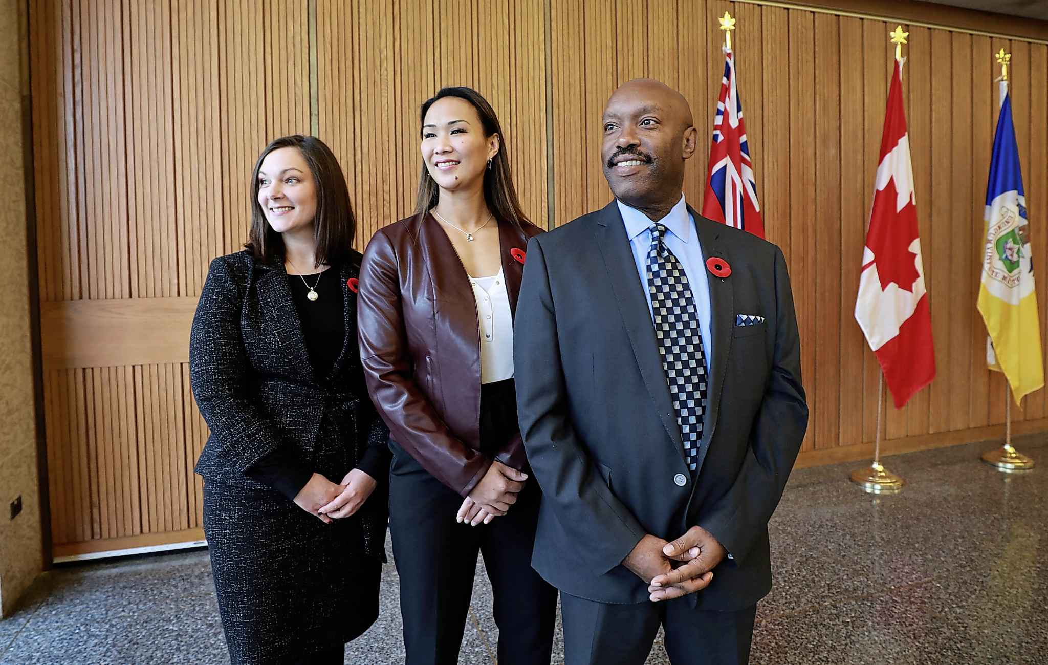 Three new council members, Sherri Rollins, Vivian Santos and Markus Chambers pose for photo at City Hall Monday afternoon after mayor Brian Bowman announces EPC members.