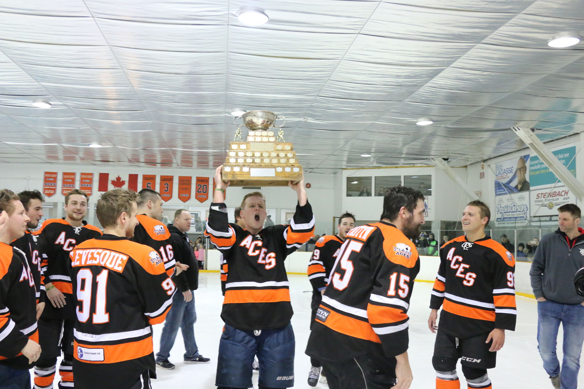 Tanner Harms celebrates with the hardware after Harms scored the winning goal just 58 seconds into overtime as the Ste. Anne Aces beat the Grunthal Red Wings 1-0 Sunday afternoon at Ste. Anne to win their third straight CSHL crown.