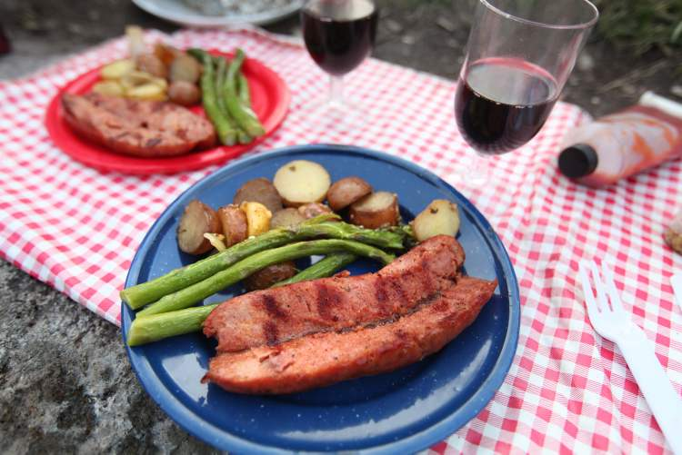 One of the earlier meals during the trip included pre-made potato surprise, grilled asparagus and smokies.