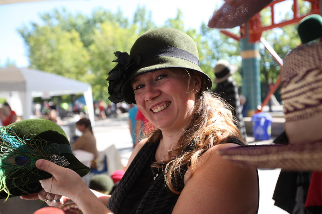 Sherri Hrycay, owner of Sova Design, shows off her designs at The Forks Saturday. (Ruth Bonneville / Winnipeg Free Press )