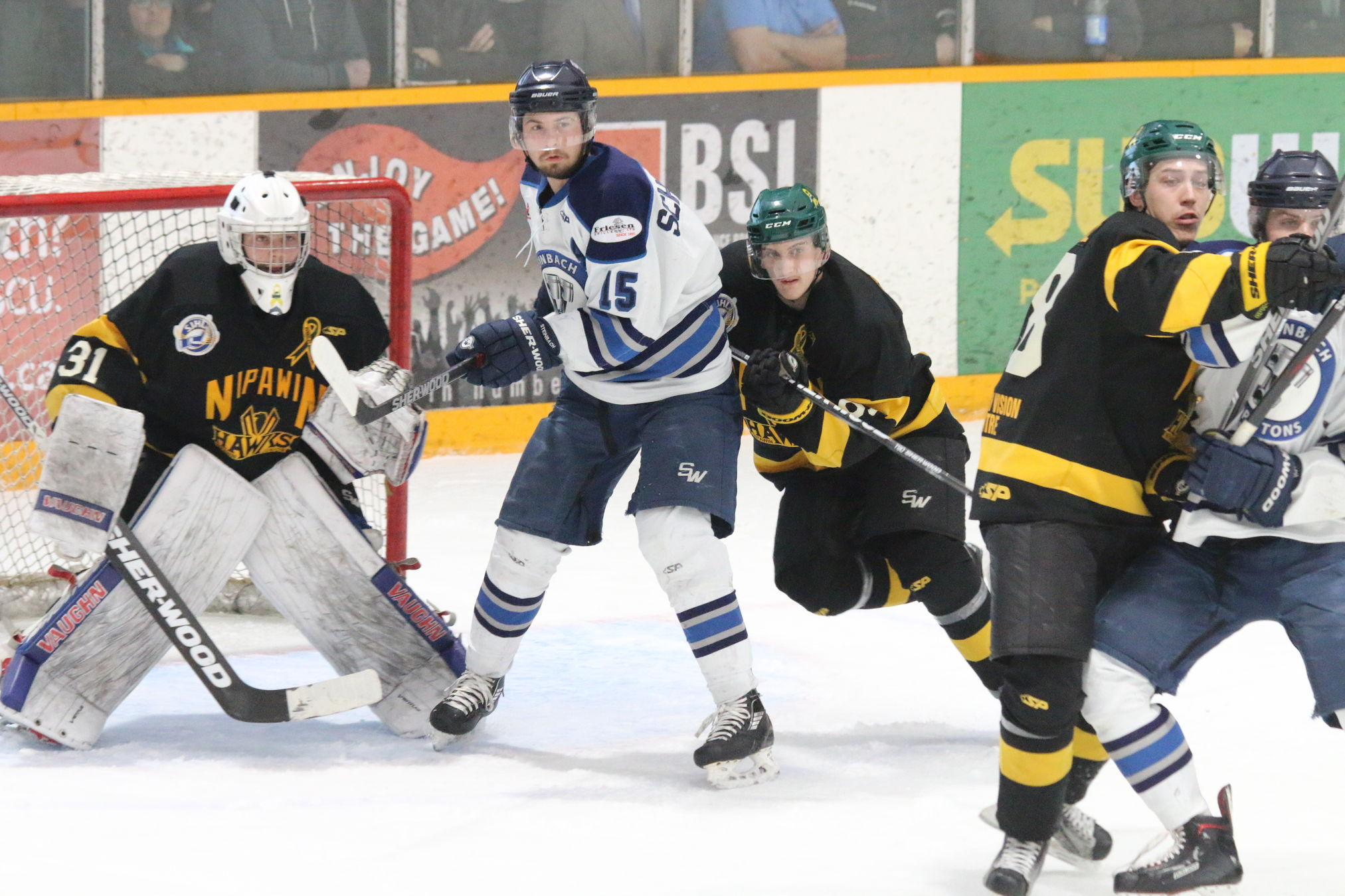The Steinbach Pistons battle in front of the Nipawin Hawks net Saturday night in Steinbach as the Pistons scored three third period goals to defeat the Hawks 3-1 and tie the ANAVET Cup series 1-1.