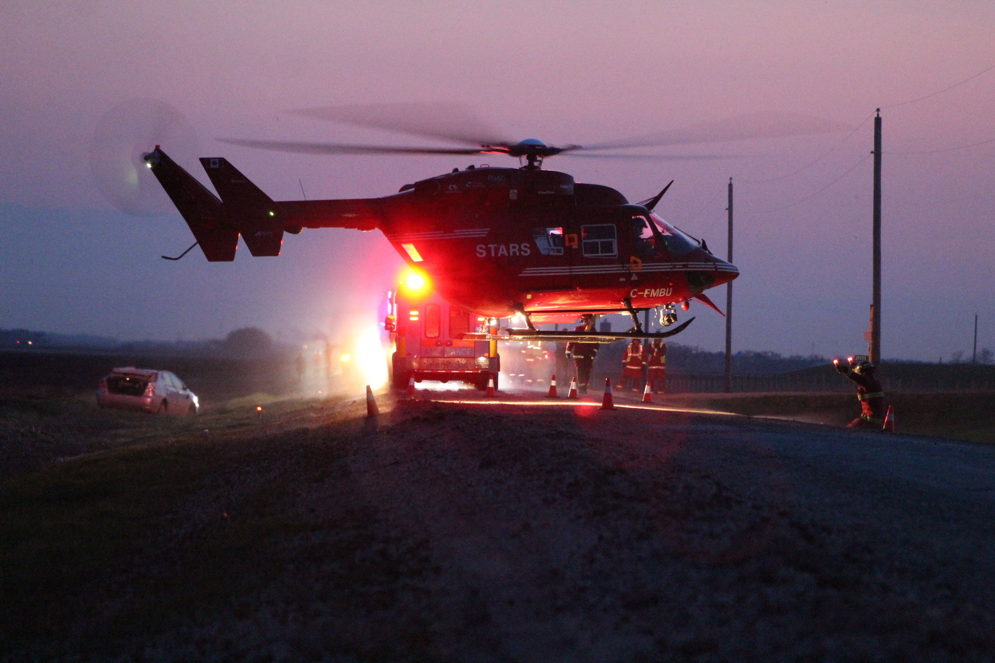 A STARS air ambulance touches down at the scene of a single vehicle rollover northwest of Mitchell Saturday evening.