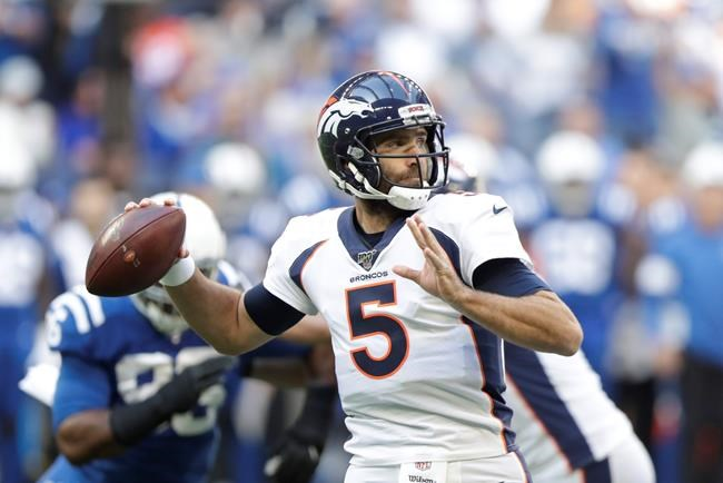 Denver Broncos quarterback Joe Flacco (5) throws during the first half of an NFL football game against the Indianapolis Colts, Sunday, Oct. 27, 2019, in Indianapolis. (AP Photo/Michael Conroy)