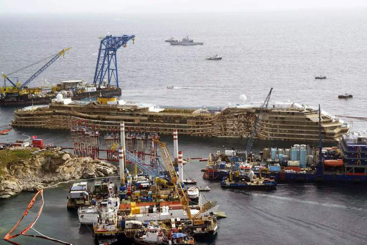 The Costa Concordia ship is seen after it was lifted upright, on the Tuscan Island of Giglio, Italy, Tuesday morning, Sept. 17, 2013.  (Alessandro La Rocca / The Associated Press)