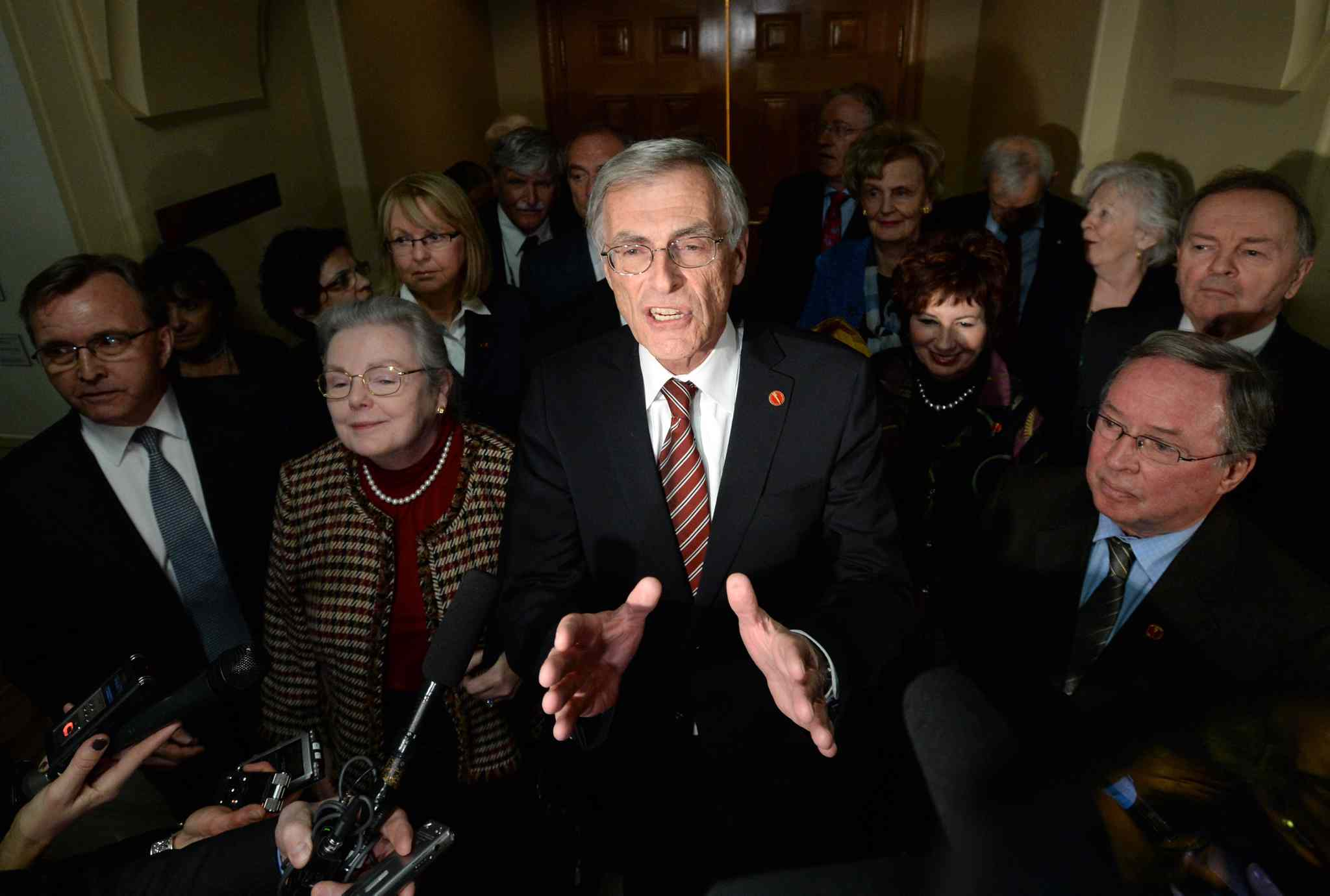 James Cowan, flanked by other newly declared Independent senators, speaks following the announcement they had been removed from the Liberal caucus.