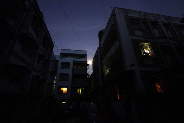 A building is seen dark following a power outage in Kolkata, India, Tuesday, July 31, 2012. India's energy crisis cascaded over half the country Tuesday when three of its regional grids collapsed, leaving 620 million people without government-supplied electricity for several hours in one of the world's biggest blackouts. (AP Photo/Bikas Das)