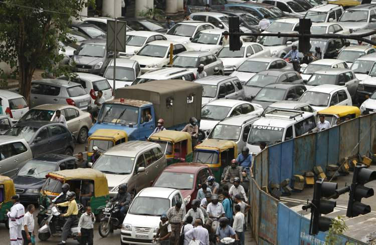 A traffic jam following power outage and rains in the central part of New Delhi, India, Tuesday, July 31, 2012. Indian officials say the nation's northern and eastern power grids have failed, leaving about half the country without power. The collapse of the grids Tuesday afternoon came a day after the northern grid failed and left eight states without power for much of the day.(AP Photo/ Rajesh Kumar Singh) (CP)