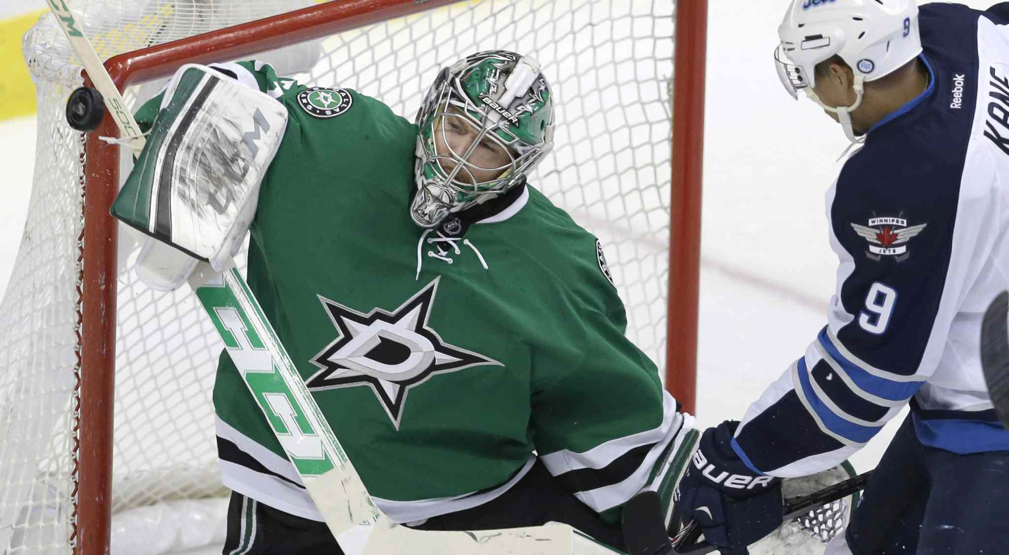 Dallas Stars goalie Kari Lehtonen blocks a shot from Winnipeg Jets left-winger Evander Kane (9) during the second period of an NHL game at American Airlines Arena in Dallas Monday. The Jets lost 2-1.