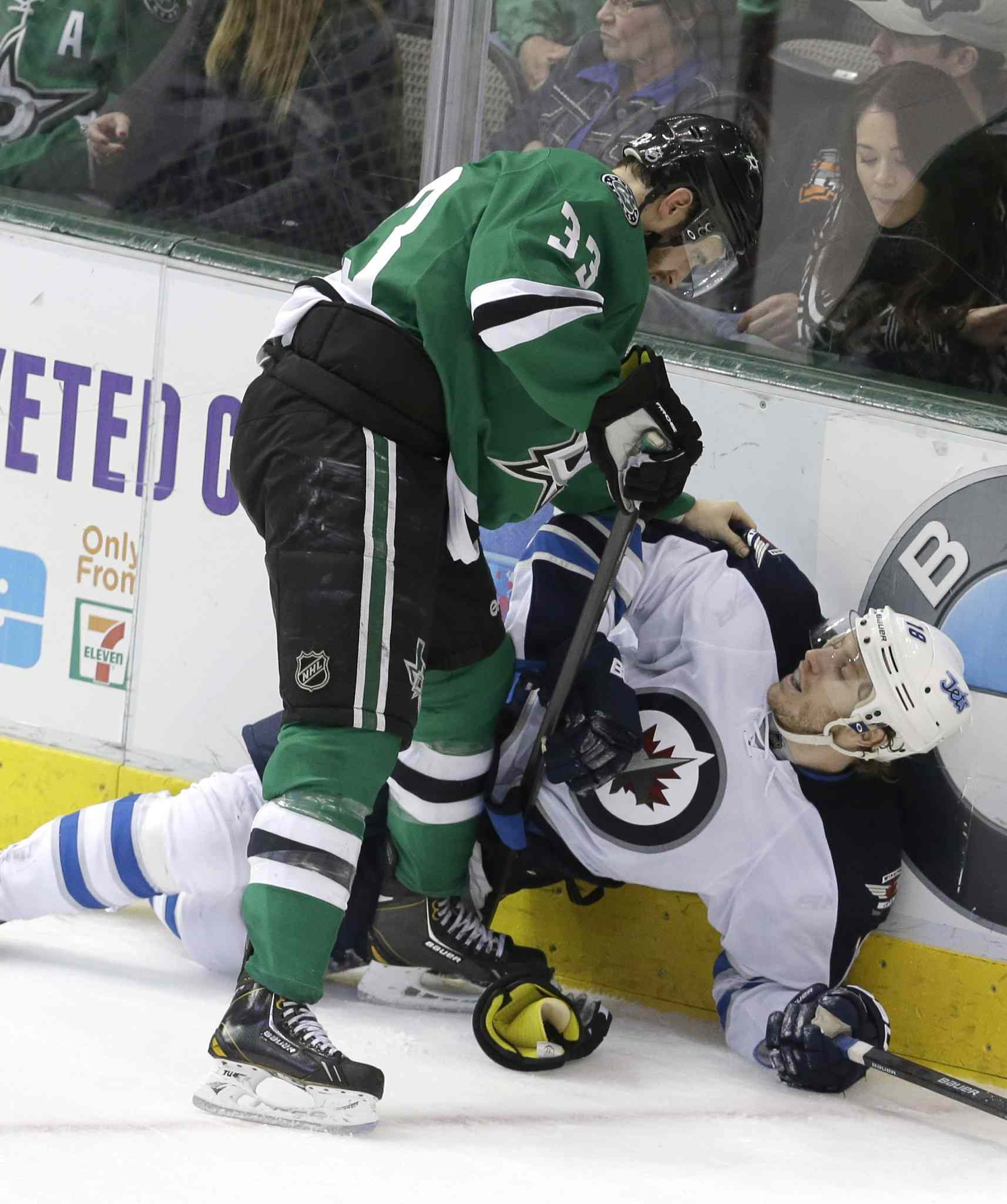 Winnipeg Jets centre Bryan Little is knocked down by Dallas Stars defenceman Alex Goligoski during the third period .