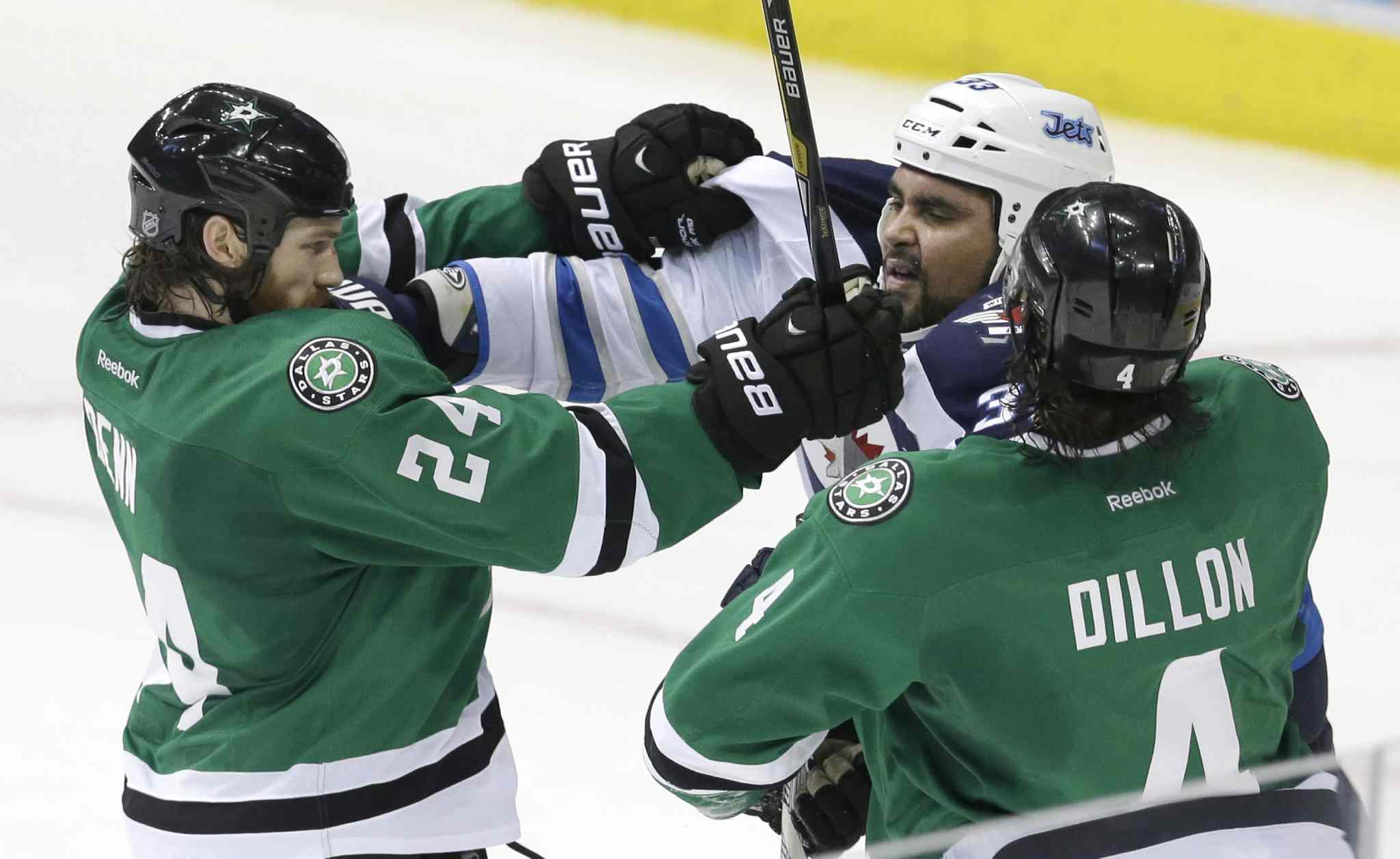 Winnipeg Jets forward Dustin Byfuglien tangles with Dallas Stars defencemen Jordie Benn (left) and Brenden Dillon during the third period.