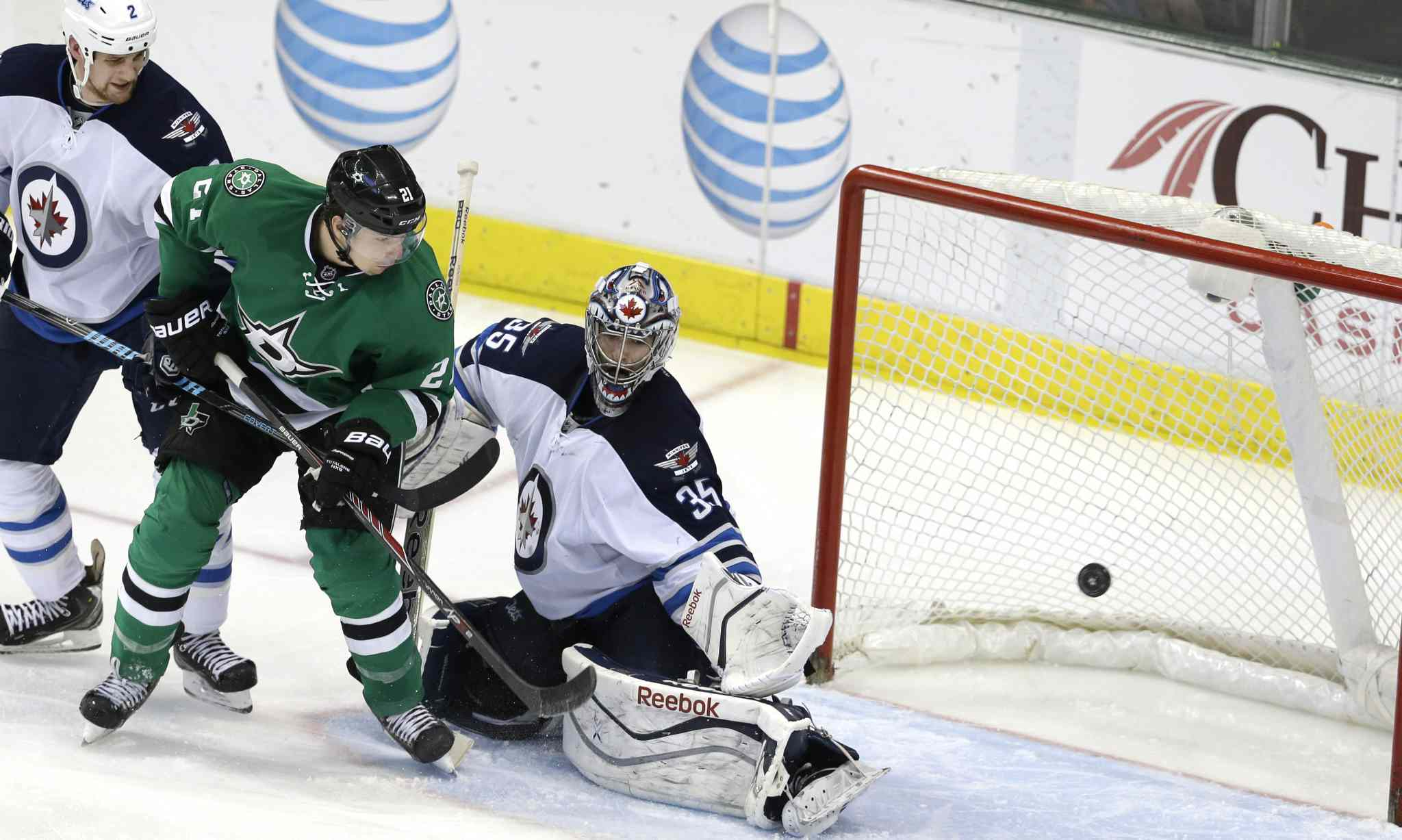 Dallas Stars left-winger Antoine Roussel (21) watches his shot go wide of  the net against Winnipeg Jets goalie Al Montoya and defenceman Adam Pardy during the second period.