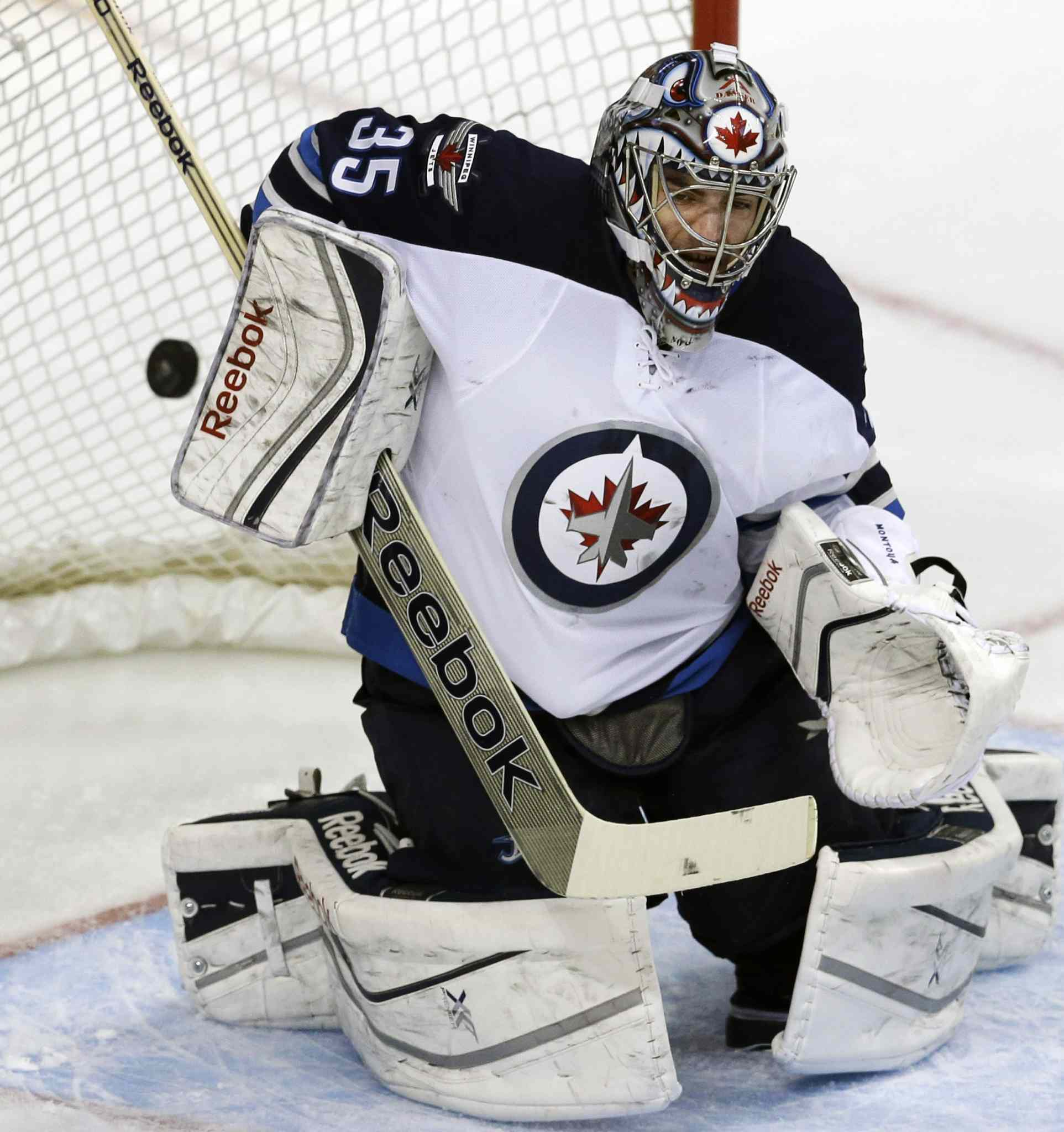 Winnipeg Jets goalie Al Montoya can't stop the shot by Dallas Stars forward Ray Whitney during the first period.