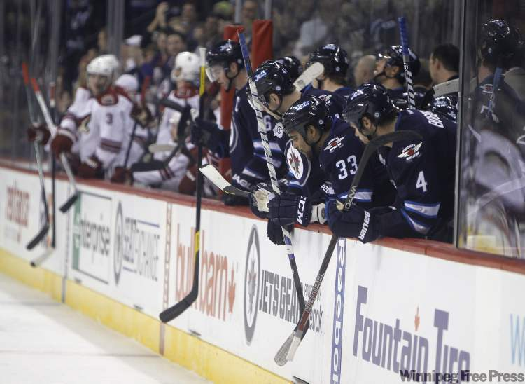 Fans and players from both teams salute Phoenix Coyotes' captain, and former Winnipeg Jet, Shane Doan, partway through the first period as the Winnipeg Jets host the Phoenix Coyotes at the MTS Centre for the only time this season.