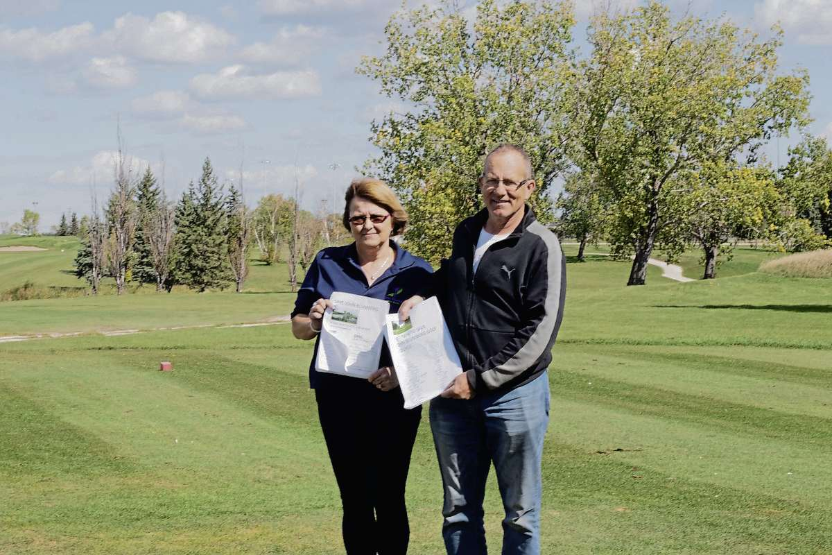 Sept. 14, 2021 - Tracy Huston (left) and Brian Campbell have worked hard to collect hundreds of signatures in support of saving John Blumberg Golf Course over the course of the year. (JOSEPH BERNACKI/CANSTAR COMMUNITY NEWS/HEADLINER)