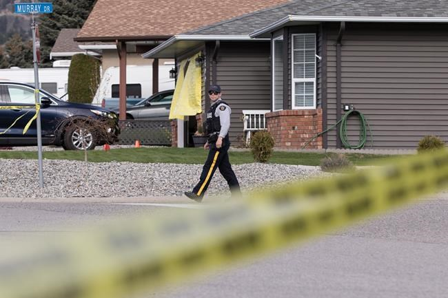 "RCMP officers work outside a crime scene in Penticton, B.C., on Monday April 15, 2019. The RCMP say a 60-year-old man is in custody after four targeted shootings in Penticton, B.C., on Monday left two men and two women dead in what a senior police officer described as a ""very dark day"" for the city. THE CANADIAN PRESS/Jeff Bassett"