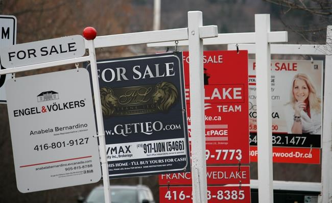 Real estate for sale signs are shown in Oakville Ont. on Saturday Dec.1 2018. THE CANADIAN PRESS  Richard Buchan