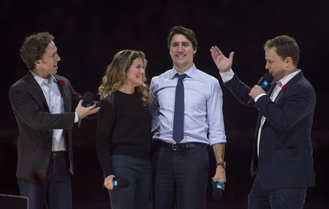 Co-founders Craig (left) and Marc Kielburger introduce Prime Minister Justin Trudeau and his wife Sophie Gregoire-Trudeau as they appear at the WE Day celebrations in Ottawa in November 2015.