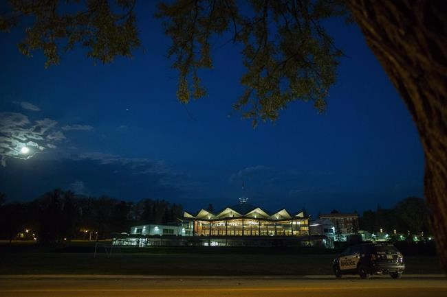 """Stratford Police sit outside the Stratford Festival's Festival Theatre after the cancellation of the opening night performance of """"The Tempest"""" in Stratford, Ont., on May 28, 2018. The Stratford Festival says despite efforts to rescue its finances from the impact of COVID-19, the organization is still has a $20-million hole in its annual budget. Carol Stephenson, chair of the board at the Stratford Festival, testified before a House of Commons standing committee on finance, asking for $8 million of support to get the arts organization back on its feet. THE CANADIAN PRESS/Geoff Robins"""