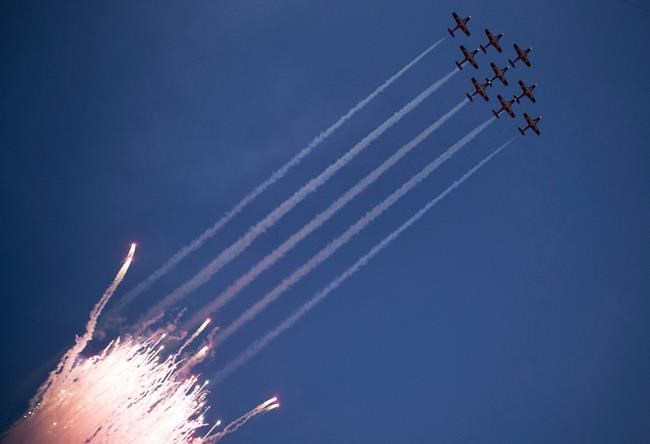 The Canadian Forces Snowbirds fly over the stadium at the start of the 106th Grey Cup in Edmonton on November 25, 2018. A military investigation has found that the ejection seat of one of the military's iconic Snowbirds planes tangled with the pilot's parachute as he tried to escape from the aircraft before it crashed in the U.S. state of Georgia last year. THE CANADIAN PRESS/Darryl Dyck