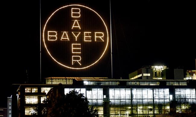 The Bayer logo shines at night at the main chemical plant of German Bayer AG in Leverkusen, Germany, on Aug. 9, 2019. THE CANADIAN PRESS/AP , Martin Meissner