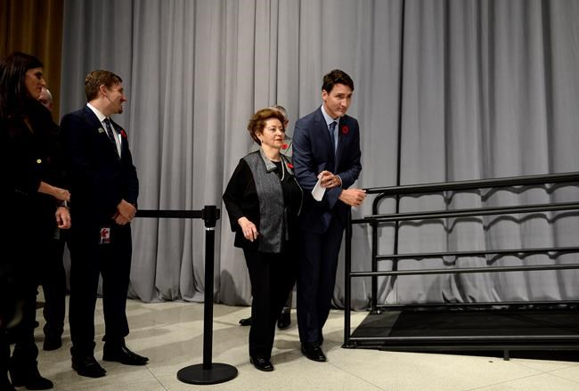 Prime Minister Justin Trudeau walks with Ana Maria Gordon, who was four-years-old when she travelled on the MS St. Louis, after their remarks at a reception following the formal apology for the fate of the ship carrying Jewish refugees in 1939, on Parliament Hill in Ottawa on Wednesday, Nov. 7, 2018. THE CANADIAN PRESS/Justin Tang
