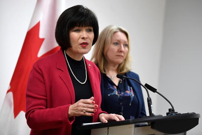Minister of Health Ginette Petitpas Taylor speaks during an announcement on funding for the opioid crisis, as Liberal MP for Ottawa-Vanier Mona Fortier looks on, in Ottawa on Monday, March 26, 2018. The government is making it easier for patients to access prescription heroin and methadone in its fight against the opioid crisis.THE CANADIAN PRESS/Justin Tang