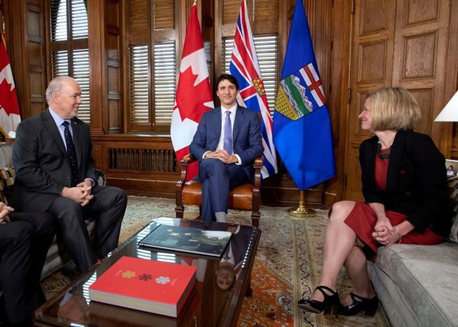 Prime Minister Justin Trudeau, B.C. Premier John Horgan, left, and Alberta Premier Rachel Notley, sit in Trudeau's office on Parliament Hill for a meeting on the deadlock over Kinder Morgan's Trans Mountain pipeline expansion, in Ottawa on Sunday, April 15, 2018. THE CANADIAN PRESS/Justin Tang