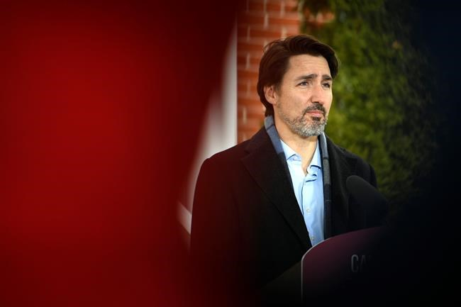 Prime Minister Justin Trudeau speaks during his daily press conference on COVID-19, in front of his residence at Rideau Cottage, on the grounds of Rideau Hall in Ottawa, on Saturday, March 28, 2020. THE CANADIAN PRESS/Justin Tang