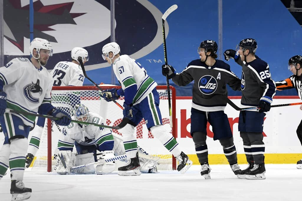 Winnipeg Jets' Paul Stastny, right, celebrates his goal against the Vancouver Canucks with Mark Scheifele during the third period in Winnipeg on Tuesday. THE CANADIAN PRESS/Fred Greenslade