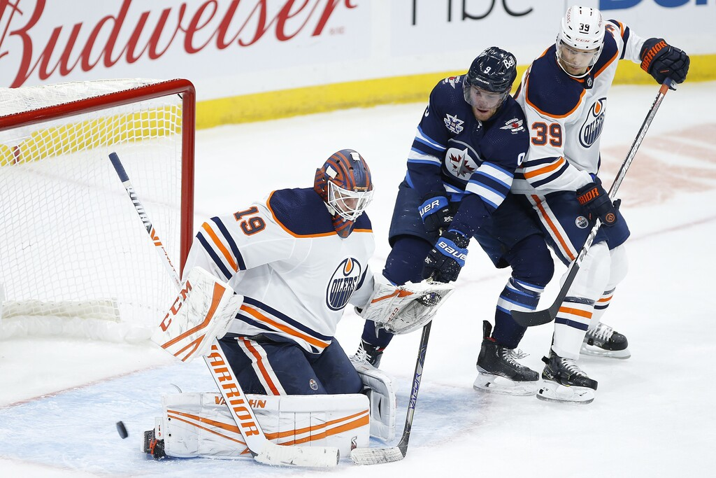 Edmonton Oilers goaltender Mikko Koskinen saves a shot from Winnipeg Jets' Andrew Copp during the third period Wednesday. THE CANADIAN PRESS/John Woods
