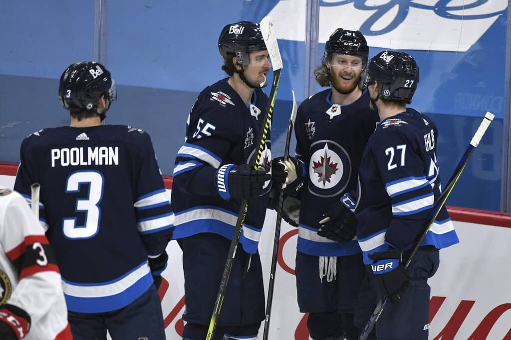 Winnipeg Jets' Kyle Connor celebrates his goal with Mark Scheifele and Nikolaj Ehlers during the second period. THE CANADIAN PRESS/Fred Greenslade