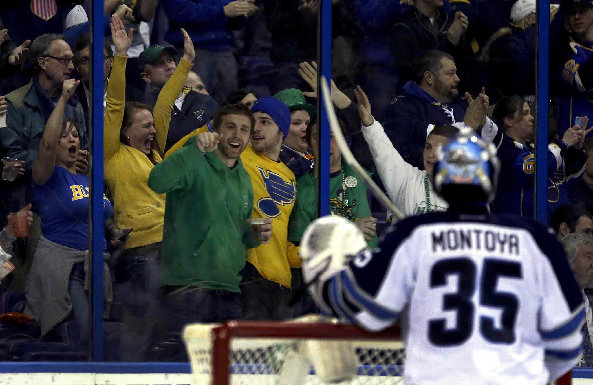 Blues fans celebrate after Jets goalie Al Montoya allowed a goal by Brenden Morrow during the second period.