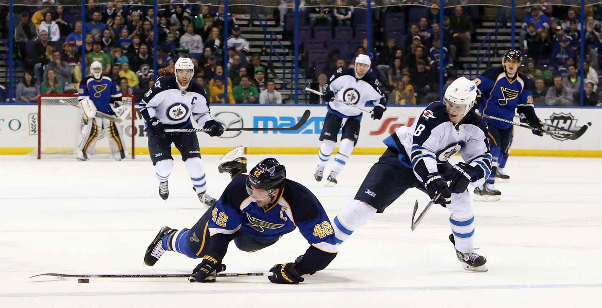 Blues centre David Backes is awarded an empty-net goal after being taken down by Jets defenceman Jacob Trouba in the third period.