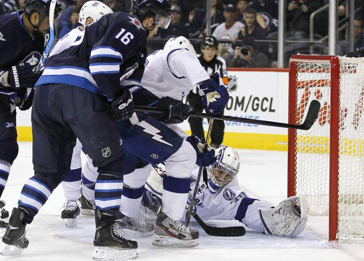 Tampa Bay Lightning goaltender Cedrick Desjardins stops a shot from Winnipeg Jets' Andrew Ladd (16) during the second period of an NHL game in Winnipeg on Sunday. (JOHN WOODS / WINNIPEG FREE PRESS)