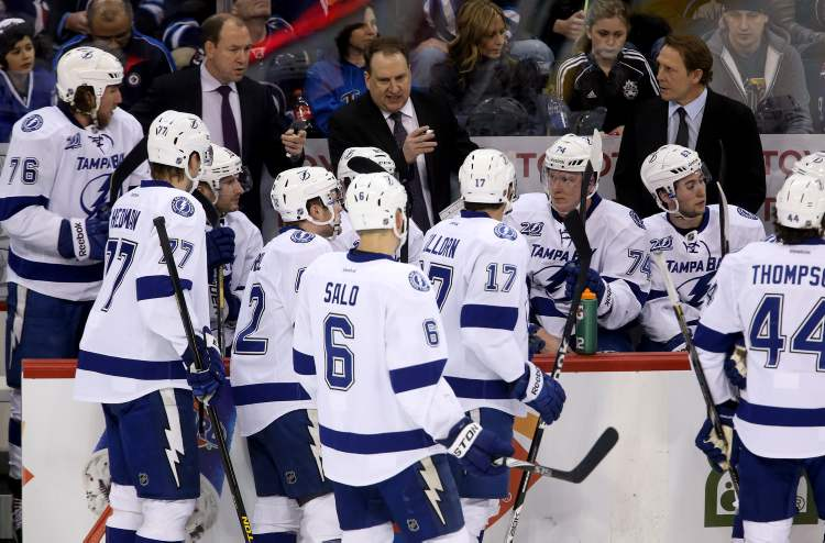 Tampa Bay Lightning assistant coaches, Daniel Lacroix and Martin Raymond and player development coach Steve Thomas in place of fired head coach, Guy Boucher, during NHL action against the Winnipeg Jets in Winnipeg, Sunday. (Trevor Hagan / THE CANADIAN PRESS)