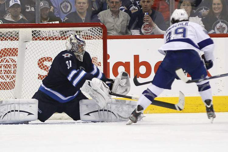 Winnipeg Jets goaltender Ondrej Pavelec shuts down the breakaway shot from Tampa Bay Lightning's Cory Conacher during second-period NHL action in Winnipeg on Sunday. (JOHN WOODS / WINNIPEG FREE PRESS)
