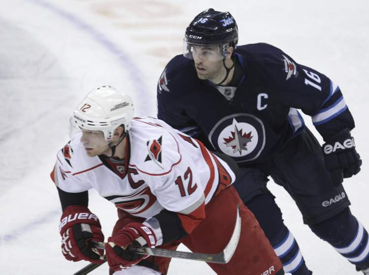 Winnipeg Jets' Andrew Ladd shadows Carolina Hurricanes' Eric Staal at centre ice in the third period.
