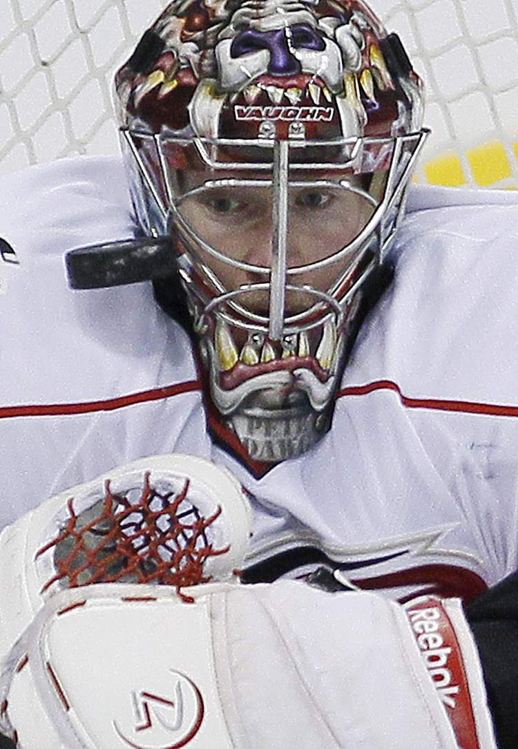 Carolina Hurricanes goaltender Justin Peters keeps his eye on the puck. (JOHN WOODS / THE CANADIAN PRESS)