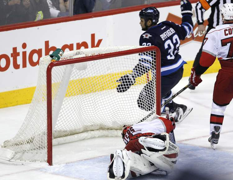 Winnipeg Jets' Dustin Byfuglien scores the game-winning goal in overtime. (JOHN WOODS / THE CANADIAN PRESS)