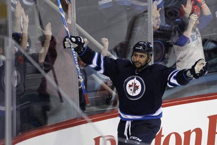 Winnipeg Jets' Dustin Byfuglien (33) celebrates after scoring the game-winner in overtime.