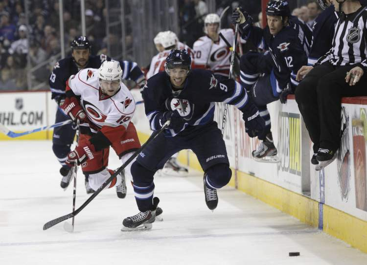 Winnipeg Jets' Evander Kane (9) chases after the puck with Carolina Hurricanes' Jiri Tlusty (19) in pursuit in the second period.  (MIKE DEAL / WINNIPEG FREE PRESS)